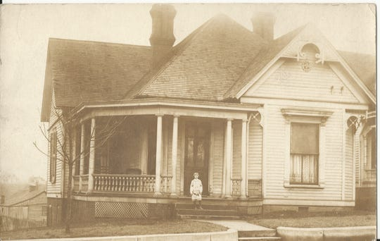 A photo of the home at 634 Madison Street taken in 1912, with 6-year old is Laura Conrad Byers standing on the doorstep.
