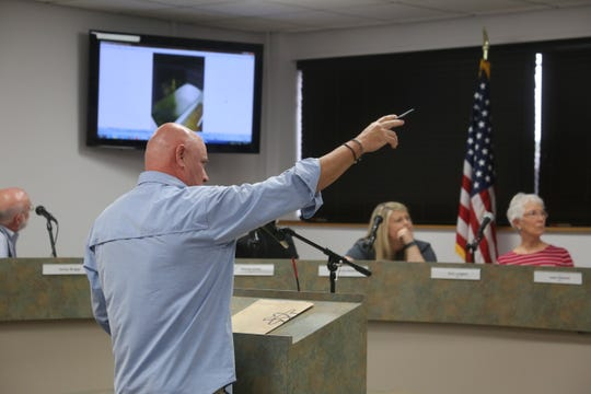Todd Beck, the prospective buyer of 634 Madison Street, points to a photo as he discusses his request to allow the demolition of the historic home at the Aug. 26, 2019, meeting of the Clarksville/Montgomery County Regional Planning Commission.