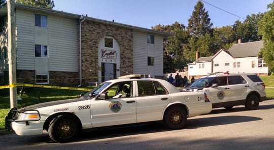 Des Moines police investigate a shooting in the 1400 block of Capitol Avenue on Tuesday morning in Des Moines, Iowa.