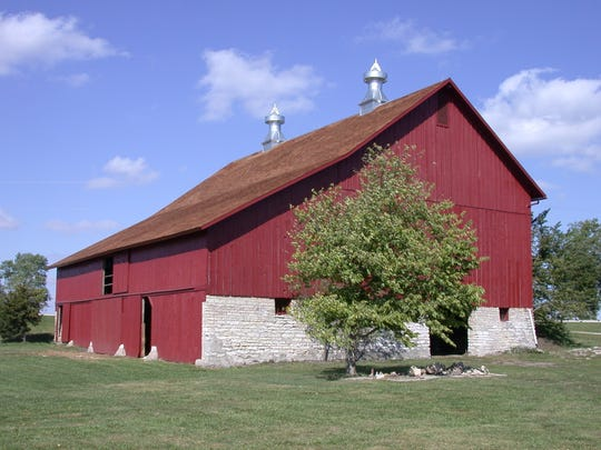 """McBroom-Hargis barn, 1218 Highway 169, Winterset (Madison County): Article in Madison County paper (1884) discussed this barn, """"It would be the largest barn in this part of the county."""" It has a wooden track, post and beam, pegs and was designed by I.F. Carter of De Soto."""