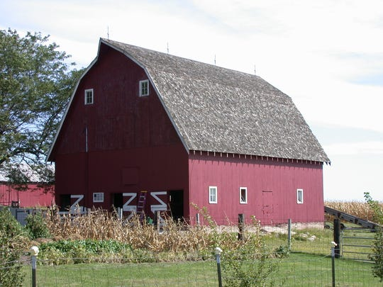 Robert & Carla Uetz Barn, 2011 180th Street, Boone (Boone County): Uniquely framed 36x50 barn with large loft was built in 1928 by William Smalley for teams and small dairy herd. Original overhead manure removal system still in place.