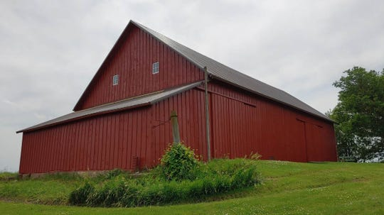 Apland/Freeland, 7304 Highway 210, Cambridge (Story County): Glorious pegged barn was built by Jens Russell for Norwegian immigrant Ole Apland. Original carving likely written by Ole Apland in Norwegian marks the date construction was completed. Barn sits in historic Norwegian settlement and remains with some of the original family.
