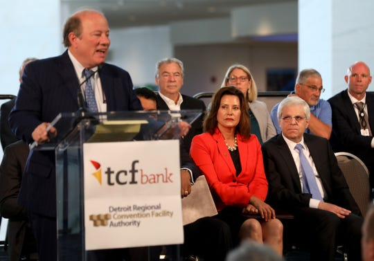 Michigan Governor Gretchen Whitmer looks and listens to Detroit Mayor Mike Duggan talk to the crowd during the renaming ceremony from Cobo Center to TCF Center in downtown Detroit, Michigan on Tuesday, August, 27, 2019.