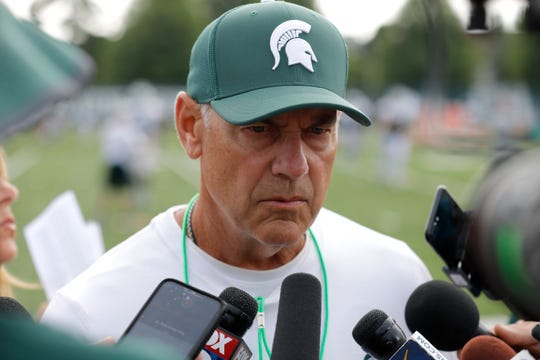 Mark Dantonio talks to reporters Aug. 12.
