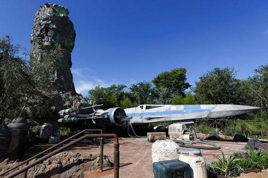The X-Wing ship stands ready for flight at the Galaxy's Edge in Hollywood Studios at Disney World, Tuesday, Aug. 27, 2019, in Lake Buena Vista, Fla.