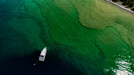 Researchers on GLERL's R/V Storm study sinkholes in northern Lake Huron off the coast of Alpena, Michigan this July.
