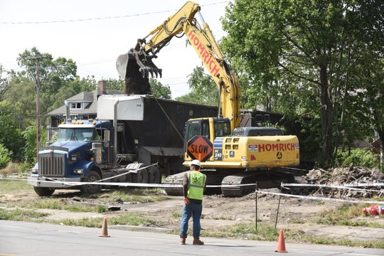 A demolition crew works on removing debris from the site where a home was torn down along Wyoming south of I-96 in Detroit in August.