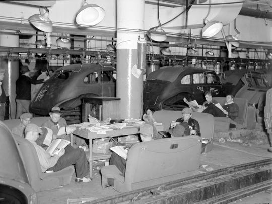 Striking autoworkers sit on car seats inside a GM factory in Flint in 1937.  The 44-day strike, historians agree, would become the most important strike in American labor history.