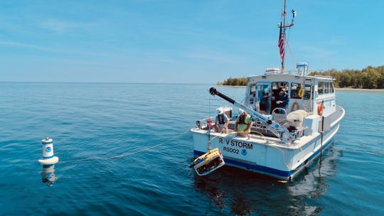 Researchers on GLERL's R/V Storm deploy an ROV to install flow meters at the Middle Island Sinkhole in Lake Huron.