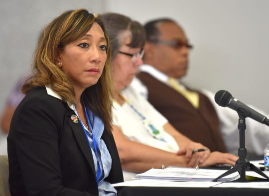 Members of the Michigan Civil Rights Commission (MCRC), from left, Mary L. Engelman, Regina Gasko-Bentley and Pastor Ira Combs, Jr., listen during the public comment portion of a meeting in Detroit Tuesday.
