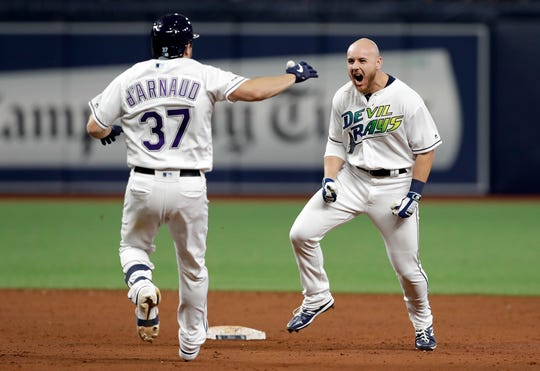 The Tampa Bay Rays' Mike Brosseau, right, celebrates his walk-off single against the Tigers on Aug. 17. Brosseau played at Oakland University.