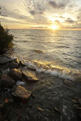 The shoreline of Lake Huron as waves wash over the rocks. The weather service is warning of dangerous swimming conditions for parts of the Thumb on Tuesday.