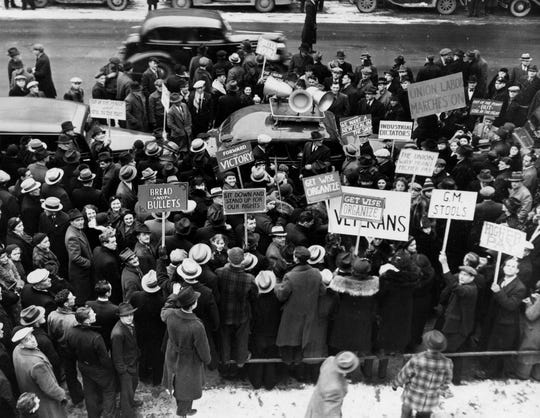Demonstrators gather outside of General Motors Plant #2 in Flint during a strike in the winter of 1937.