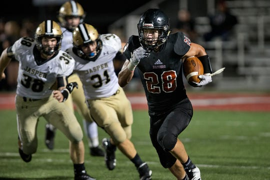 Southridge's Cole Calvert runs the ball against Jasper in last year's game in Huntingburg. This will be the final time the two teams will meet on the football field for the foreseeable future.