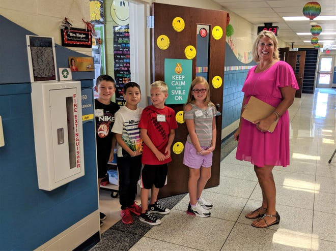 Grade 4 students Elliot Laird, Jovany Lopez, Dominic Spring, and Alana Ayers, and their teacher Mrs. Kerri Ziegler getting ready for a building tour on the first day of school at Bataan Memorial Intermediate, Port Clinton School District.