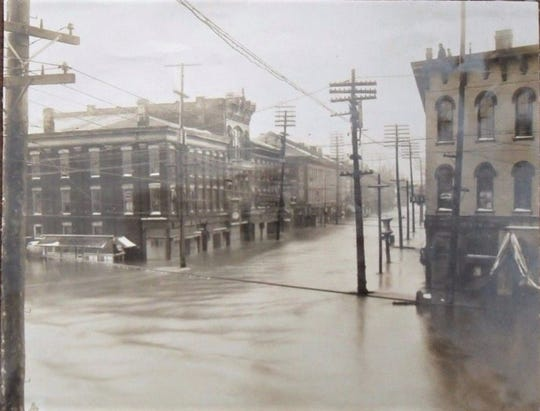 In the 1913 flood, Front Street was flooded at the corner of West State Street.