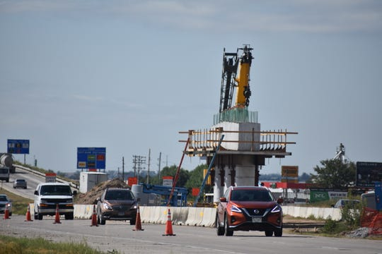 Vehicles pass by construction of the new Vine Drive bridge over Interstate 25 north of Fort Collins on Tuesday.