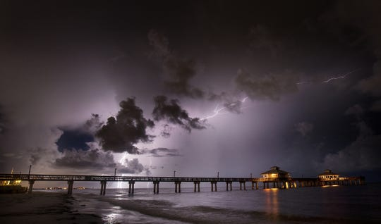 Lightning strikes in the Gulf of Mexico near the Fort Myers Beach pier on Monday, August 26, 2019. Recent storms have created light shows throughout Southwest Florida.