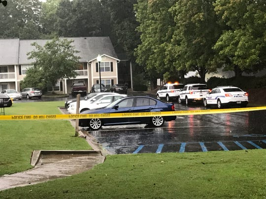 Police cruisers line a street at a Greenville apartment complex following a more than four-hour standoff ended with an arrest.