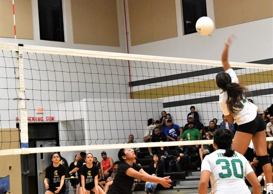 John F. Kennedy Islanders outside hitter Kiana Rivera his a quick set in the middle and finds no block, putting the ball down during their IIAAG Girls Volleyball opener against the Tiyan Lady Titans at Tiyan Aug. 27. JFK won 3-0.