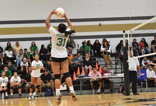 John F. Kennedy Islanders setter Valerie Escalona, No. 31, looks to throw it outside to No. 10 Kiana Rivera during their IIAAG Girls Volleyball opener against the Tiyan Lady Titans Aug. 27 at Tiyan. JFK won 3-0.