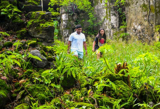 Xavier Quinata, 18, and his sister, Samaria Quinata, 13, explore the ruins of the San Dionisio Areopagita Church in Umatac on Saturday, Aug. 24, 2019. Both siblings participated in the archeological excavation of the ruins, during the summer of 2016, aiding visiting  archeologists from the University of Hawaii.