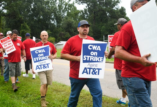 AT&T workers and members of the Communication Workers of America strike in front of the AT&T office near 1305 W. Seventh St. in Hattiesburg Aug. 27, 2019.
