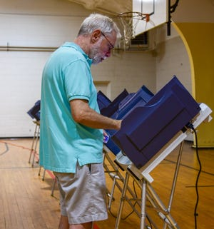 Richard McCarthy cast his vote during the Forrest County runoff election at Thames Elementary School on Tuesday, Aug. 27, 2019.