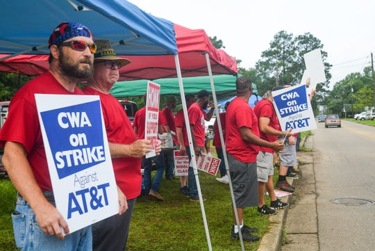 AT&T workers and Communication Workers of America union members stand alongside W. Seventh Street outside of AT&T offices in Hattiesburg on strike over unfair bargaining practices Aug. 27, 2019.