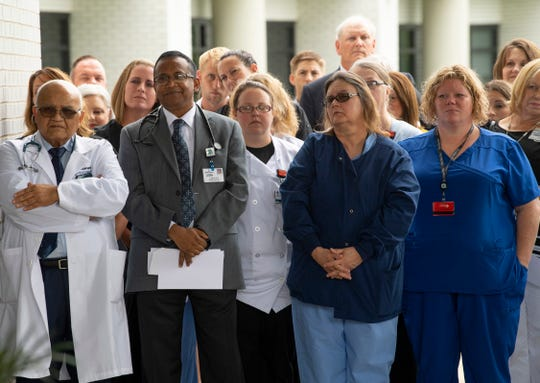 Medical personnel at the new Deaconess Clinic/Heart Group Henderson facility at Methodist Hospital gather for a ribbon cutting Tuesday morning. The facility will host 14 physicians and providers for cardiology, internal and family medicine as well as pediatrics.