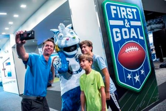 """Take a photo with a life-sized statue of Blue at """"First & Goal,"""" a new exhibit at The Children's Museum of Indianapolis all about football."""