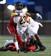Brandon High School's Cj Blakely (28) wraps up Starkville High School's Amariyon Howard (23). Brandon and Starkville played in an MHSAA Class 6A high school football game on Friday, August 23, 2019 at Brandon. Photo by Keith Warren