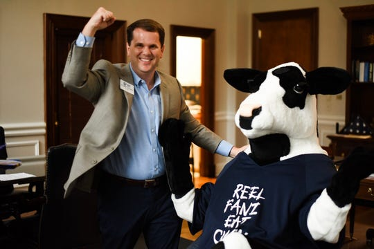 MC President Blake Thompson poses with Chick-fil-A mascot in honor of new eatery coming to the Clinton campus.