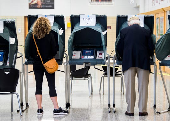 Voters cast their votes for the City of Knoxville's primary election at Bearden High School on Tuesday, August 27, 2019.