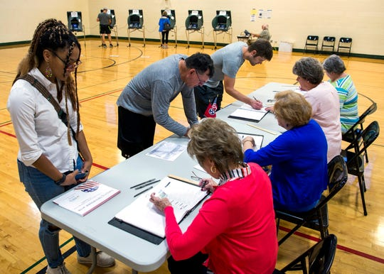 Residents prepare to vote in the City of Knoxville's primary election at Deane Hill Recreation Center on Aug. 27, 2019.