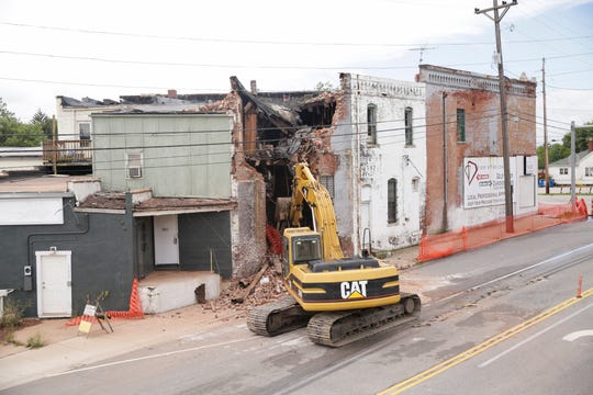 Bryan Ridenour uses an excavator to remove a wall on the E.M. Weaver Building along South st., Tuesday, Aug. 27, 2019 in Lafayette. The section of wall collapsed early Tuesday morning.