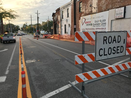 Two months after Lafayette the sidewalk along South Street, fearing that buckling bricks might give way on the E.M. Weaver Building at Main and South streets, the 152-year-old building came down.