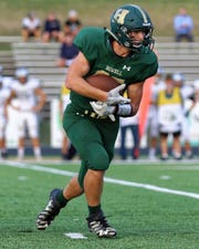 Running back Jonah Schrock could have a big season running behind a big, experienced offensive line.