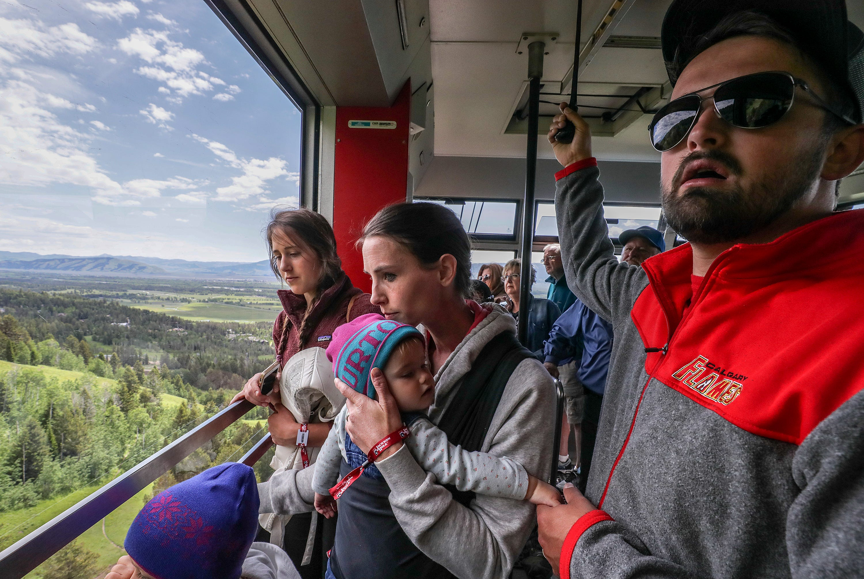Rachael Denhollander and her husband, Jacob, travel in a tram at Jackson Hole, Wyoming. June 2019
