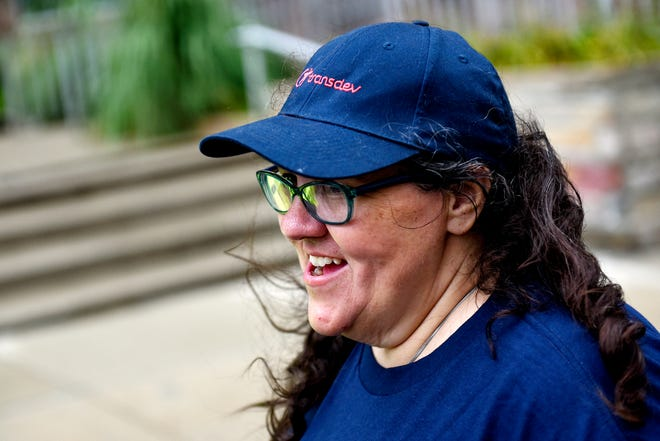 Transdev employee Jennie Harwood-Schlaack talks about problems with the CATA contractor while protesting outside Lansing City Hall on Monday, August 26, 2019, before a City Council meeting.