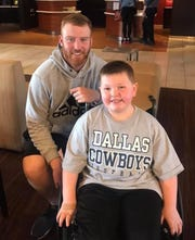 Cooper Rush, a Dallas Cowboys' quarterback and Charlotte native, with Gavin Miller. They have been friends for over a year. Miller, 8, has Perthes Disease, and lives in Rush's hometown.
