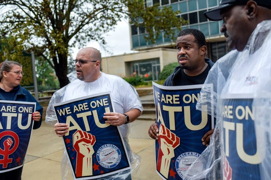 From left, Transdev employee Angela Hansen, Amalgamated Transit Union representatives Michael Cornelius, Stanley Smalls and Anthony Garland protest CATA contractor Transdev's working conditions outside Lansing City Hall on Monday, August 26, 2019, before a City Council meeting.