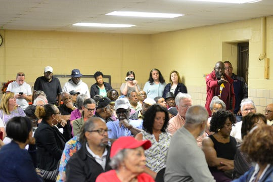 Dozens of people packed into a room Monday for a meeting that was prompted by a traffic stop involving Alomar Davenport, a candidate for Mansfield City Council's fourth ward.