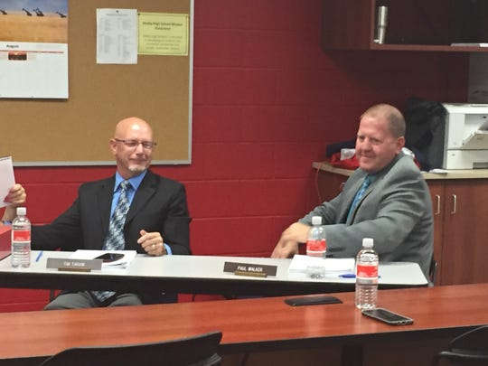 Shelby Superintendent Tim Tarvin, left, and Assistant Superintendent Paul Walker share a laugh during Monday's school board meeting.