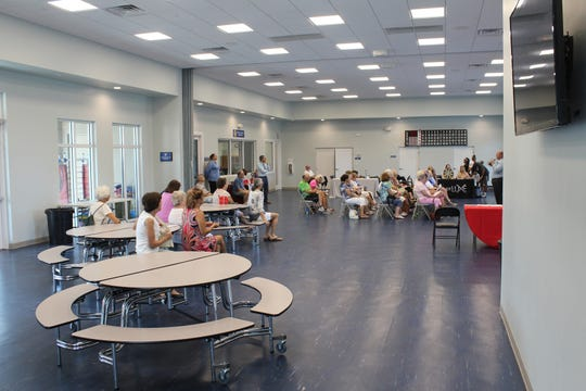 The monthly fairs are held in the Y's Youth Development Center.