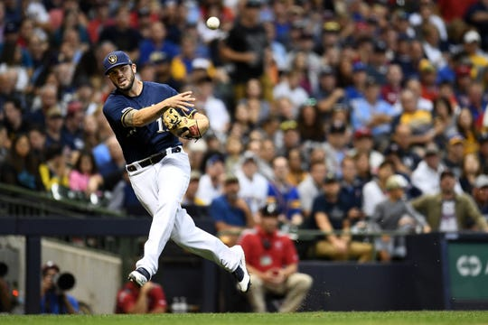 The Brewers are listing Mike Moustakas as day-to-day after the third basemman suffered a bruise to his left hand when it was hit by a sharp grounder just below his glove in the second inning in a loss to the Cardinals on Monday night.