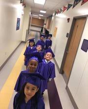 Borgwardt's 2018-2019 K5 Graduates making their way down the hallway of Rocketship Southside Community Prep to cross the stage.