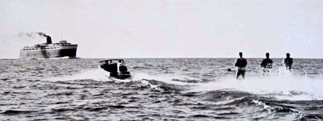 Jim Weyer, Mark Pleuss and Jerry Halderson approach the SS City of Midland ferry while skiing from Manitowoc to Ludington in 1962