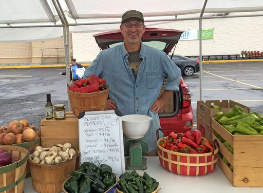 John Hendrickson sells his Beaver Dam Peppers and other produce at the Beaver Dam Pepper Festival.