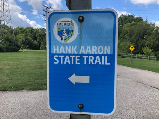 Blue signs mark the Hank Aaron Trail.